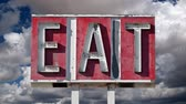 estragado : Vintage eat sign with moving clouds time lapse.
