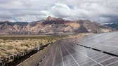 fotovoltaik : Solar energy panels with mojave desert clouds time lapse and zoom out at Red Rock Canyon National Conservation Area in Southern Nevada. Stok Video