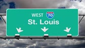 kansas : St. Louis Interstate 70 overhead highway sign with time lapse clouds. Stock Footage