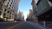 mounted : Los Angeles, California, USA - April 26, 2015:  Early morning car mount hyper lapse on 5th Street and Broadway in downtown Los Angeles.