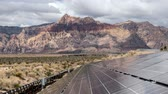 fotovoltaik : Solar Energy Panels with Mojave Desert Clouds Time Lapse and Zoom In Stok Video