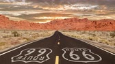 дорожный знак : Route 66 Mojave desert highway sign with romanticized sunrise time lapse.