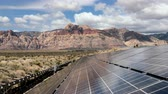 fotovoltaik : Solar energy panels with Mojave desert clouds time lapse at Red Rock Canyon National Conservation Area in Southern Nevada.