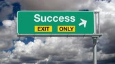 дорожный знак : Success exit only highway sign with time lapse clouds.
