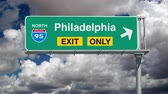 philadelphia pennsylvania : Philadelphia Interstate 95 overhead freeway exit sign with time lapse clouds. Stock Footage