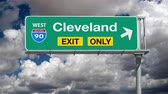 дорожный знак : Cleveland Interstate 90 Exit Sign with Time Lapse Clouds