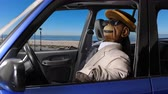 manequim : Puppet monkey enjoying a drive at the beach.