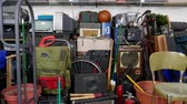 вещь : Vintage rummage filled garage dolly out shot.  Object brand names and logos were covered.
