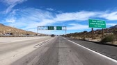 дорожный знак : Slow motion driving view of Palm Springs Highway 111 exit sign on Interstate 10 in Southern California.
