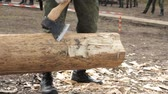 shaky : Soldier in camouflage with an ax sharpening log