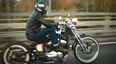biker : A young man riding a chopper on a road Stock Footage