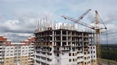 construction of a multi-storey residential building, two cranes work