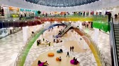 Russia, Lipetsk, Riviera shopping center, people go shopping, go on the escalator Stock Footage