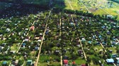 suburbs : Village fly over aerial survey tilt shift miniature Stock Footage