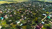 miniatura : Village fly over pan aerial survey tilt shift miniature Stock Footage