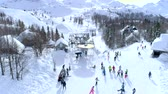 multicopter : Group of skiers at the top of the ski lift aerial in winter