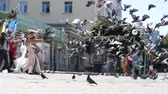 marry : Pigeons beautifully scatter over the square