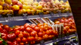 westminster : Peaches, kiwi, tomatoes and other vegetables and fruits are cooled on the shelf