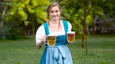 waitress : Attractive woman in blue bavarian costume. Oktoberfest theme Stock Footage