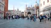 marco : Crowd in the main Venice square. Palace and tower