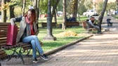 tab : Modern student with red hair in the park using the tab. Early autumn Stock Footage