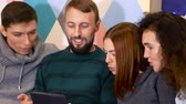 láhve : Group of people enjoy carefree time. Beardy guy shows his ipad, everybody sit with open mouths. Celebration concept