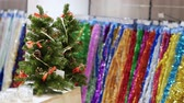 bombki : Xmas trees with colored decorative baubles in store. New year and Christmas preparations concept