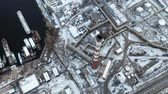 global cooling : Birds eye view of industrial zone near the pier. Massive red and white pipe