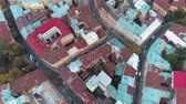 Flying over colored roofs of the old city Lviv. Cultural centres of Ukraine.