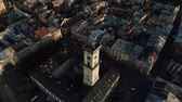 Aerial view of town hall in Lviv. Fly over market square at sunset. Cultural center of Ukraine