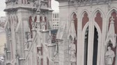 Drone pan shot of neo gothic church. Roman Catholic Church of Saint Nicholas.