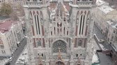 Aerial pan shot of Gothic church. Roman Catholic Church of Saint Nicholas. Vídeos