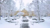 Aerial footage of Kiev Polytechnic University in winter. Snowy stairs to the main campus