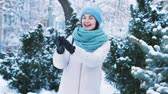 Brunette throwing snowball outdoors and having fun. Winter pastime concept Vídeos