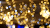Christmas bokeh background. Defocused. Colorful lights at the New Years Fair Vídeos