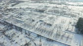 transmitir : Overall plan of electric power station in winter. Aerial view Stock Footage
