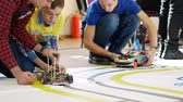 Kyiv, Ukraine - February 22, 2019: Students test a robotic car model on a special track. At the robotics competition