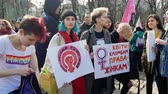 Kyiv, Ukraine - March, 2019: Feminists hold signs at womens march in Kiev
