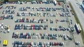 Fly over the parking lot of used cars. Aerial footage 4k