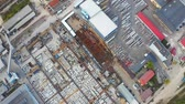 Birds eye view of industry area. Warehouses and store buildings from above. Aerial footage