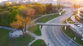 People walk in the park during a beautiful sunset. Aerial footage
