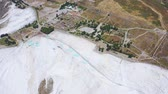 pamukkale : Top aerial view of Pamukkale in Turkey aka Cotton Castle. Mineral bath spas that abound the province of Denizli 4k
