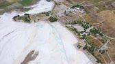 Birds eye view of Pamukkale in Turkey aka Cotton Castle. Mineral bath spas that abound the province of Denizli 4k