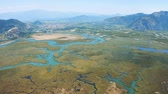カメ : Aerial survay of the river and city Dalyan, Turkey. The river that flows into the Aegean and the Mediterranean 4k