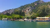 Sailing along the Dalyan river overlooking the Lycian tombs. Rock-cut tombs in Myra. Shooting from the boat to the steadicam 4k