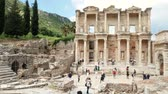 ephesus : Group of tourists on the ruins of the ancient city of Ephesus (Efes), near the Celsus library. Panoramic shot 4k