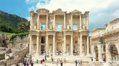 ephesus : Time lapse of Celsus library in Ephesus ancient city ruins on cloudy sky. Famous place for tourists in Izmir for historical place 4k Stock Footage