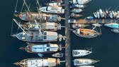 Yachts, ships and boats moored in port. View from above. Aerial footage 4k Filmati Stock