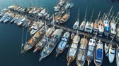 Top view of luxury yachts and boats moored in the port during the calm water. Aerial footage 4k Filmati Stock