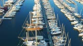 Flying past the rows of yachts and boats in the port of Bodrum. Aerial footage 4k Filmati Stock